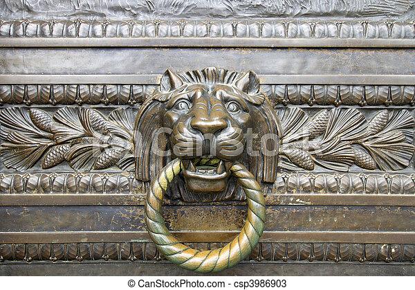 Lion Head Bronze Door Knocker - csp3986903