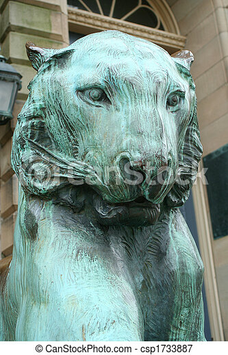 A old green copper lion statue.