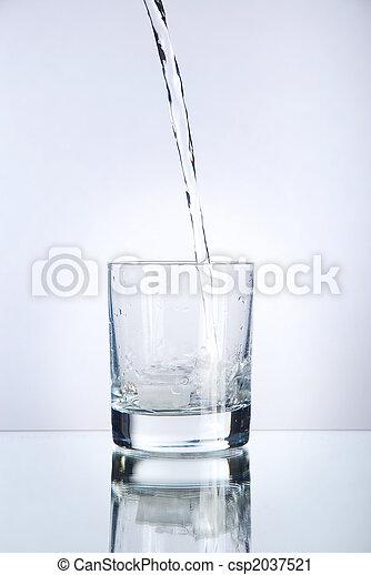 Liquid pouring into a tumbler - csp2037521