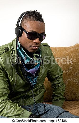 listening intently in retro 80's attire - csp1162486