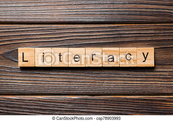 LITERACY word written on wood block. LITERACY text on wooden table for your desing, concept - csp78903993