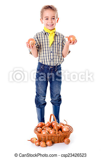 Little agriculturist holding onions - csp23426523