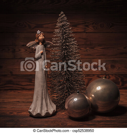 little angel near christmas tree and globes - csp52538950