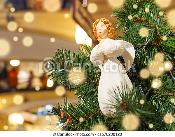 Little angel, vintage toy for Christmas tree. Traditional decoration for New Year celebration. - csp76208120