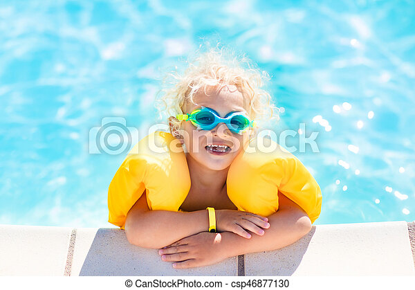 Little baby boy playing in swimming pool - csp46877130