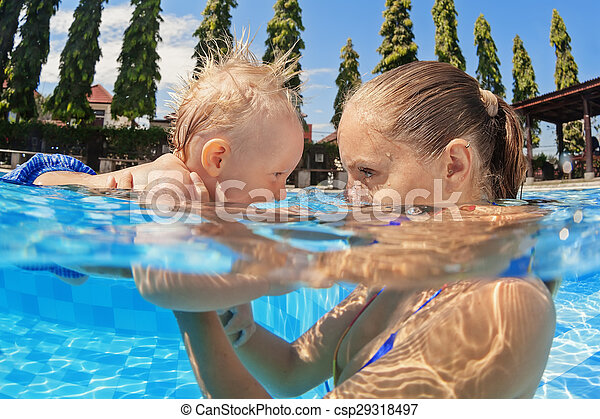 4d1b5bcdac Little baby boy swimming in outdoor pool with mother. Portrait of ...