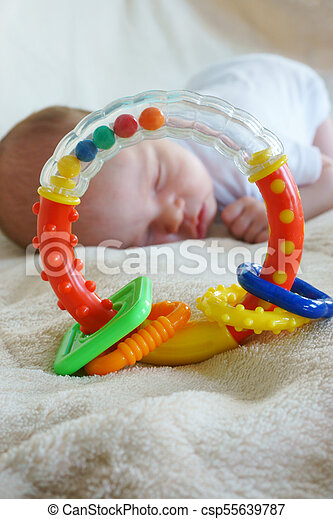 little baby is sleeping on the bed - csp55639787