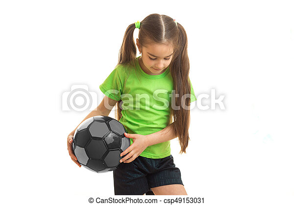 d9f9021bc Little blonde girl in green uniform playing with soccer ball ...