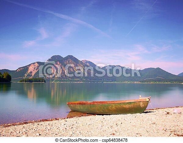 Little boat on lake shore, beautiful summer nature. - csp64838478