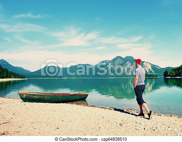 Little boat on lake shore, beautiful summer nature. - csp64838510