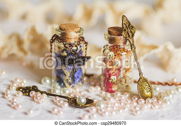 Little bottle full with colorful dried flowers - csp29480970
