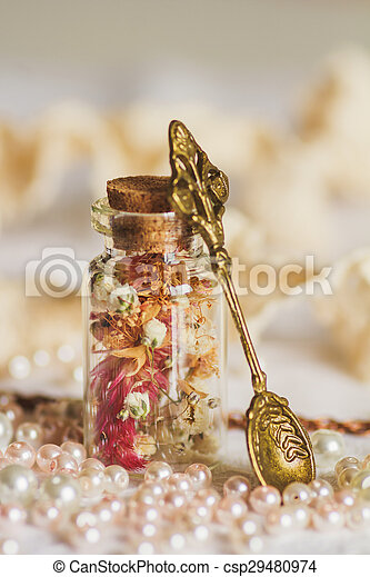 Little bottle full with colorful dried flowers - csp29480974