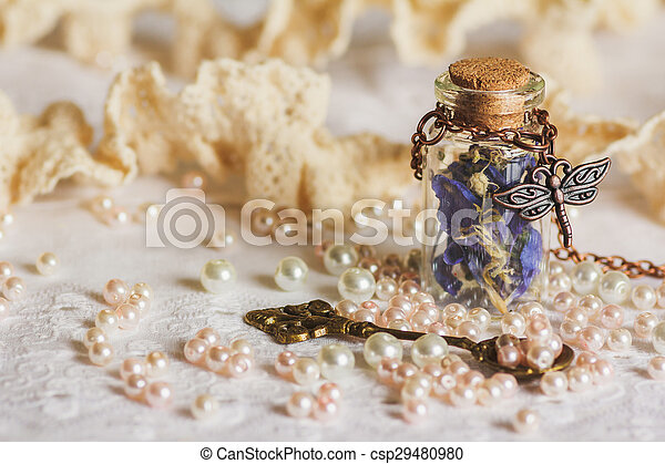 Little bottle full with colorful dried flowers - csp29480980