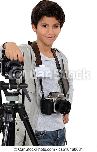 little boy acting like a professional photographer - csp10468631