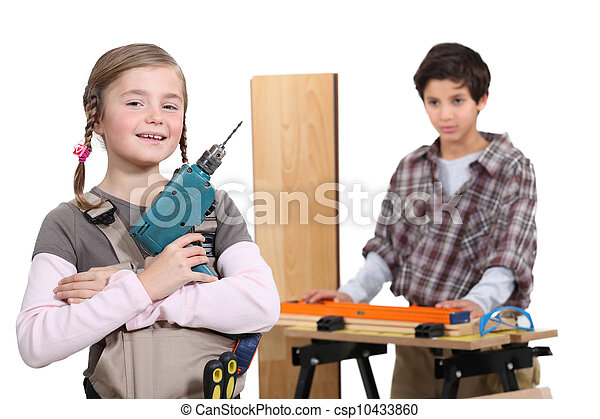 little boy and girl in a craftsman workshop - csp10433860