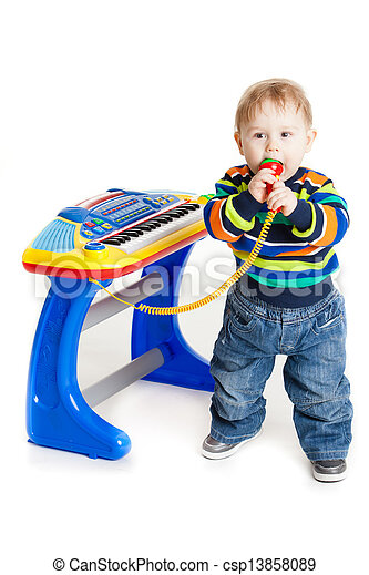 little boy and the keyboard on white background. funny boy baby. young DJ - csp13858089