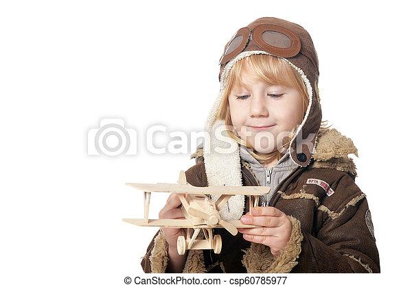 Little boy aviator wit wooden plane toy - csp60785977