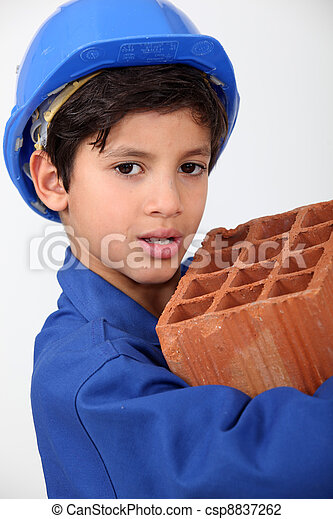 Little boy carrying brick - csp8837262