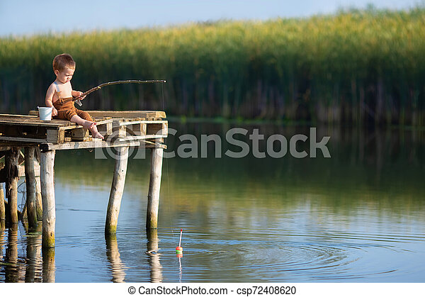 little boy fishing on the lake - csp72408620