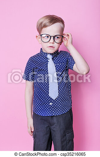 2770cc7f185 Little boy in tie and glasses. Portrait of a little smiling boy in a ...