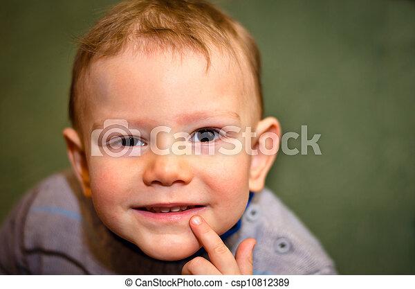 little boy interrogatively looks upwards - csp10812389