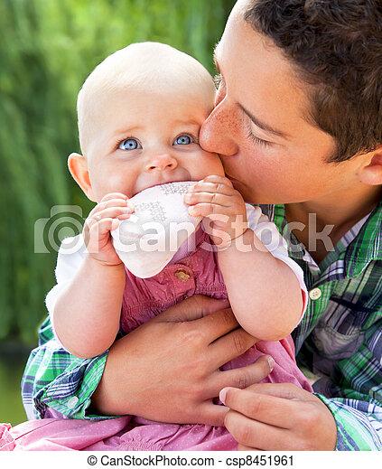 Little boy kissing baby sister - csp8451961