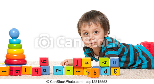 Little boy near blocks with alphabet - csp12815553