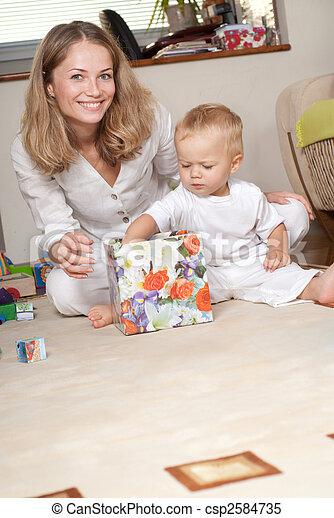 Little boy opens present box - csp2584735