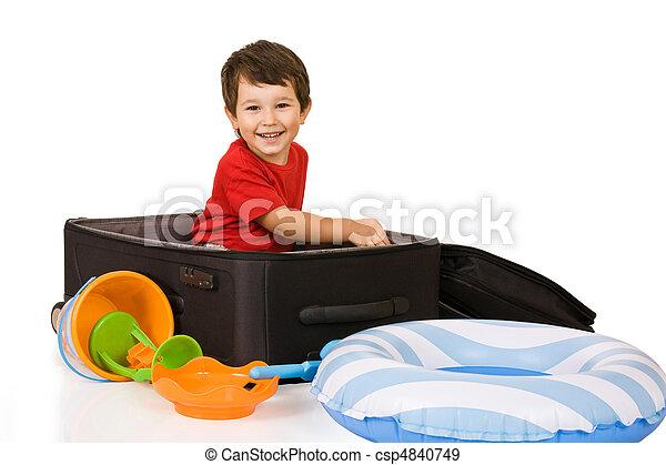 Little boy packs a suitcase - csp4840749