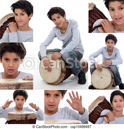 little boy playing on a traditional drum - csp10499497