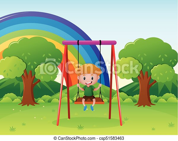 Little boy playing on the swing in the park - csp51583463