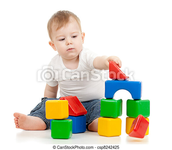 little boy playing with building blocks - csp8242425