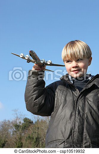 Little boy playing with toy plane - csp10519932