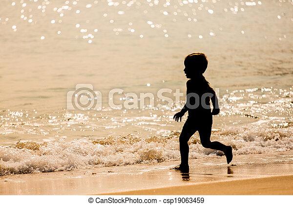 Little boy running on the beach - csp19063459