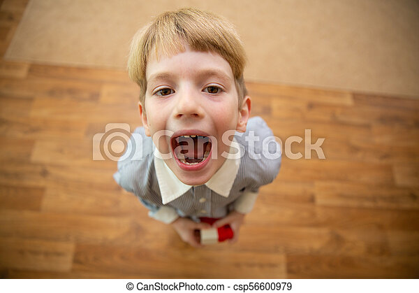 little boy screaming boy with open mouth view from above