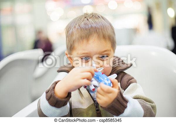 Little Boy Toy Airplane - csp8585345
