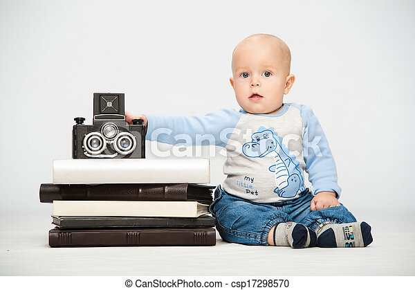 little boy with a film camera - csp17298570
