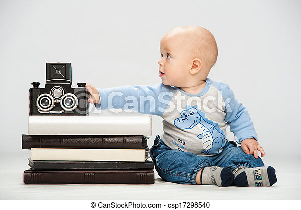 little boy with a film camera - csp17298540