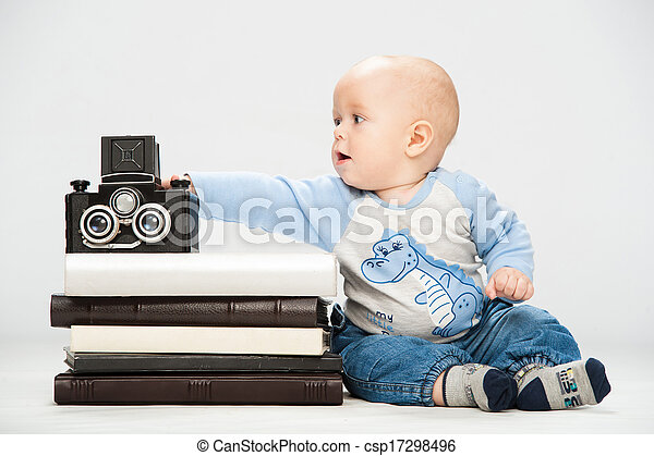 little boy with a film camera - csp17298496