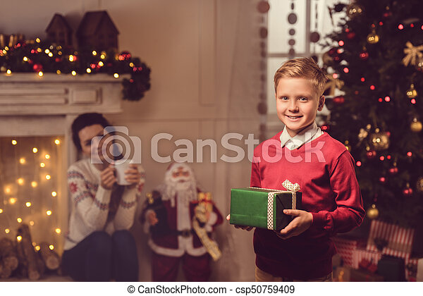 little boy with christmas present - csp50759409