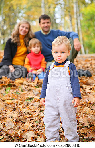 Little boy with family in forest in autumn - csp2606348