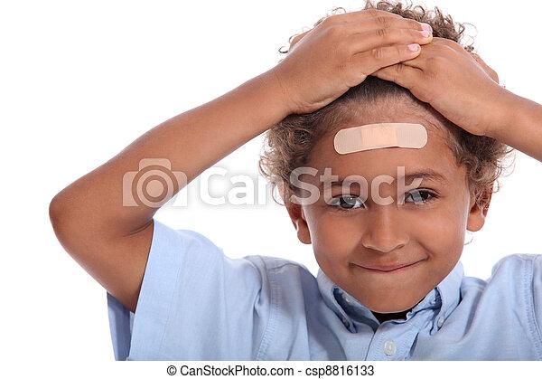 Little boy with plaster on head - csp8816133