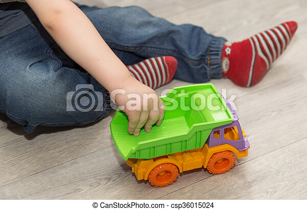 Little Boy 39 S Hand Holding A Toy Car Top View