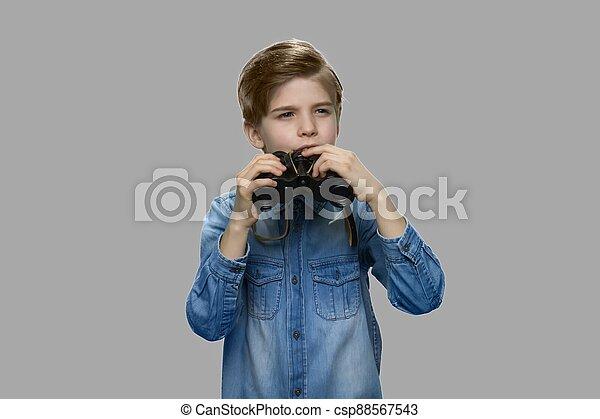Little caucasian boy using binoculars. - csp88567543