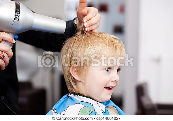 Little child getting a blow dry at the hairdresser - csp14861027