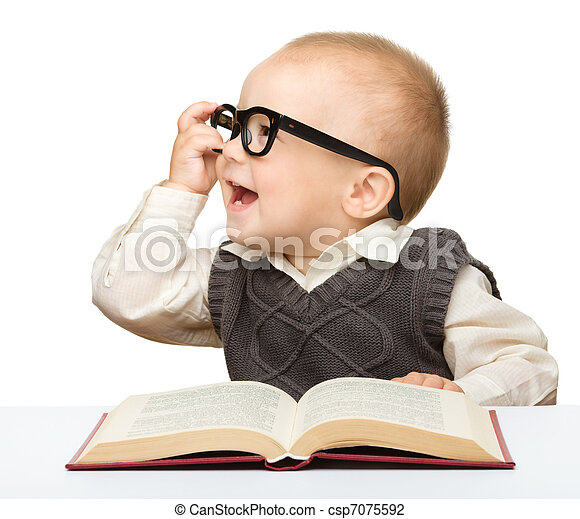 Little child play with book and glasses - csp7075592