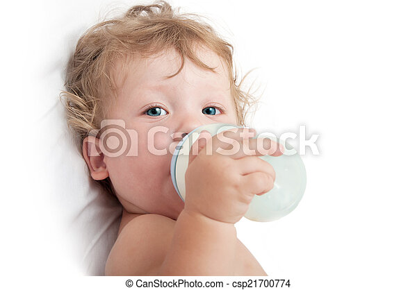 little curly-headed baby sucks a bottle of milk - csp21700774