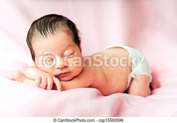 Little cute baby girl on a pink background - csp15500599