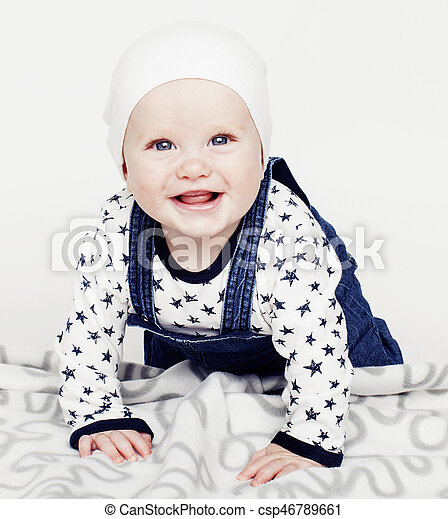 a3ed35f86 little cute baby toddler on carpet isolated close up smiling ado -  csp46789661