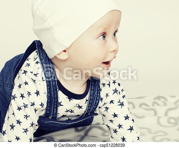 5fc7e82f7 little cute baby toddler on carpet isolated close up smiling ado -  csp51228039